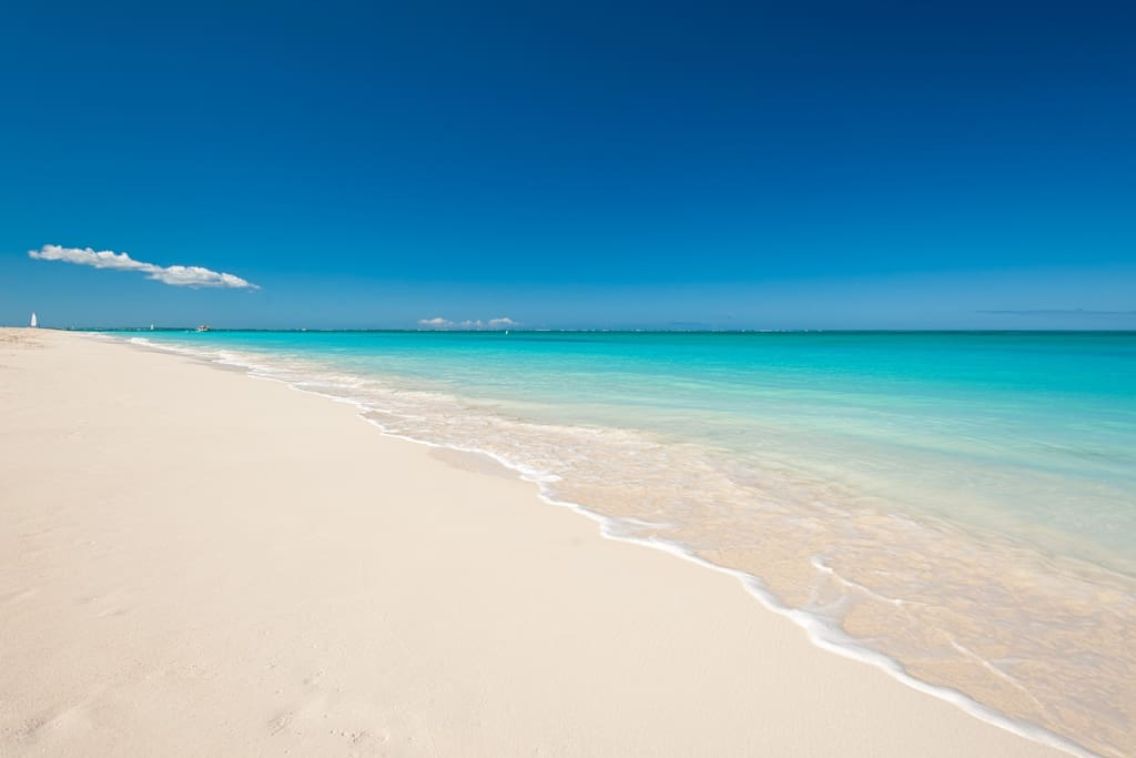 Grace Bay Beach - just 2 blocks (5 mins) away - the resort even has chairs there for you to enjoy it!