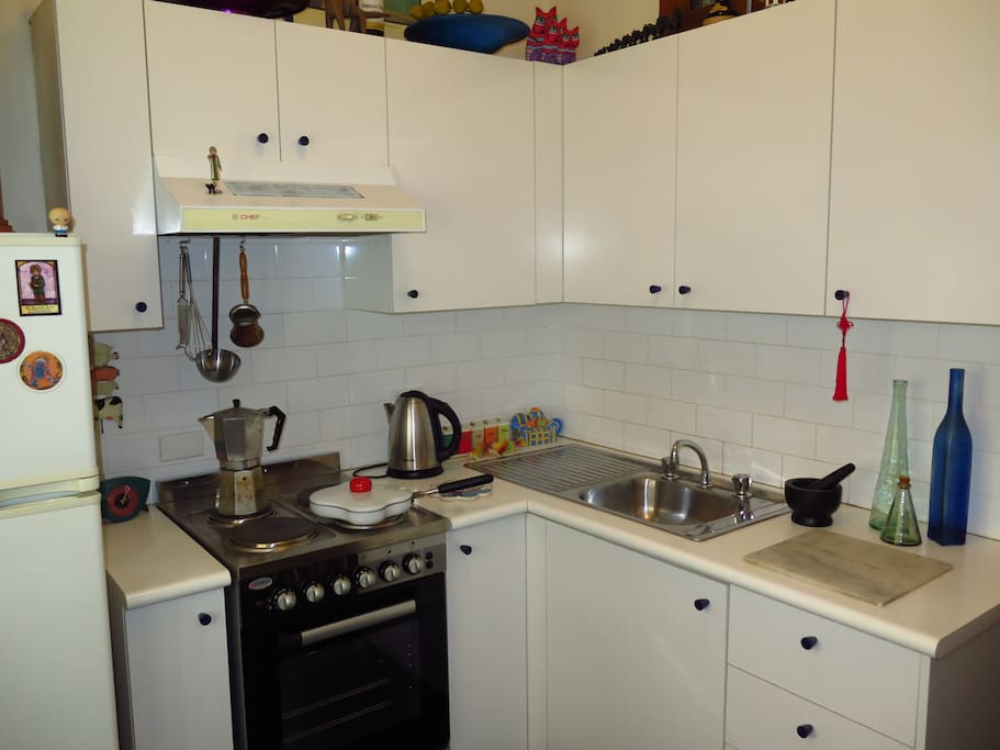 A fully equipped kitchen with large pantry