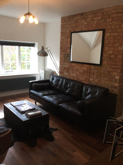 The living room with exposed brick walls.