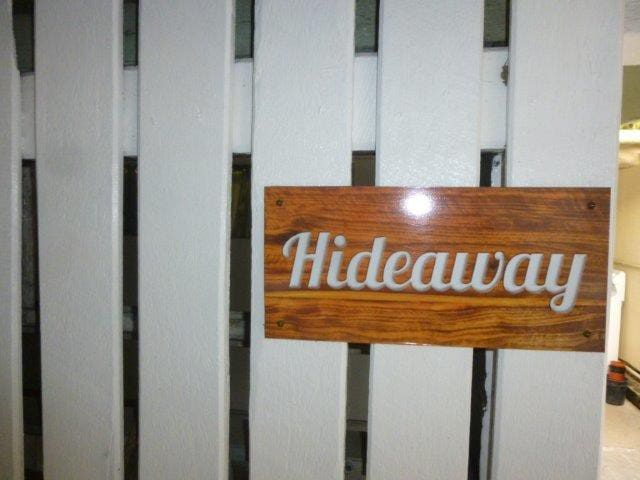 It is called Hideaway because it is tucked away from the world  in a quiet location on the park