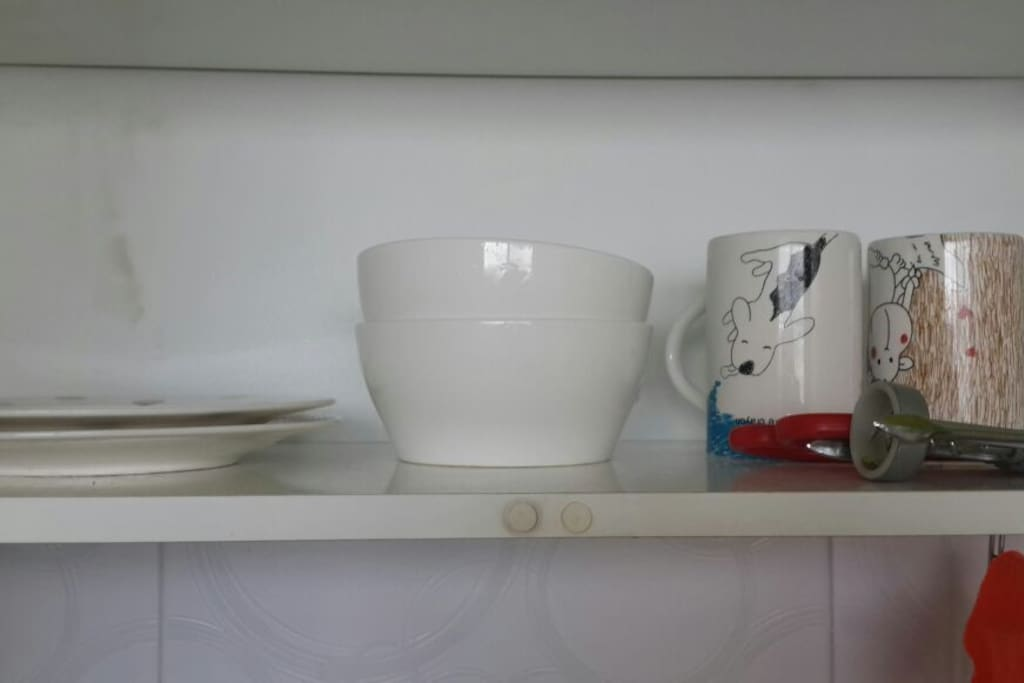 Dishes, bowls and mugs for two with utensils, knife and cork opener