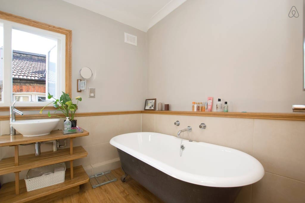 Nice tub and shower bathroom with wooden floors