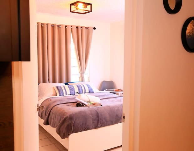 Spacious room with air conditioner.