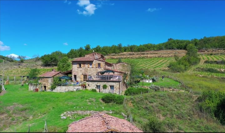 Farmhouse on top of a Chianti Hill with lake