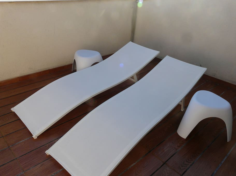 Relaxing deck chairs on the terrace.