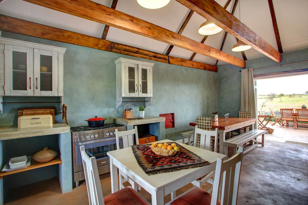 Kitchen with gas stove & electric oven.