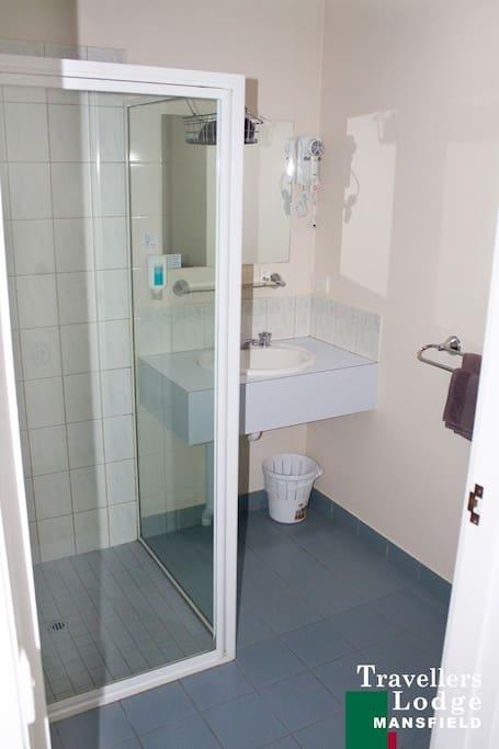 Pristine, clean bathrooms with basic toiletries