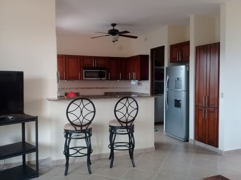 Big kitchen with all kitchen ware including coffee maker, microwave, dishwasher
