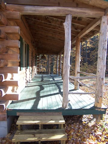 Looking east along the front porch.  Adirondack settee and additional chairs removed for clarity!  :)