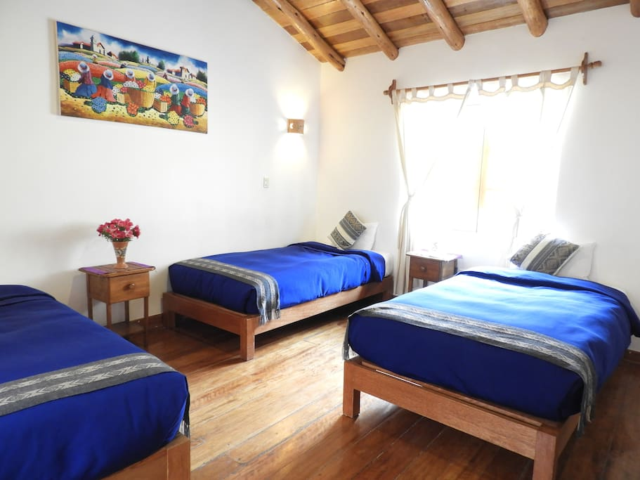 A spacious room in the middle of the house with majestic 180 degree views of both the sacred mountain of Pinkuylluna, the terraces of the fort and the cobbled lanes below with a background sound of the Inca water channel.