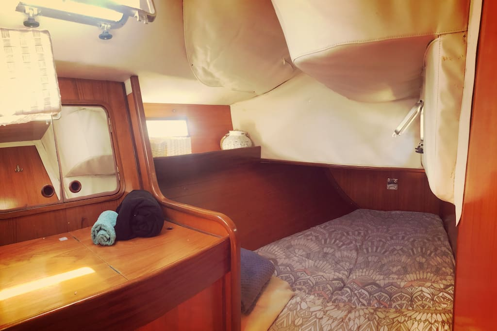 This is your bow cabin with three little windows. Lots of light!