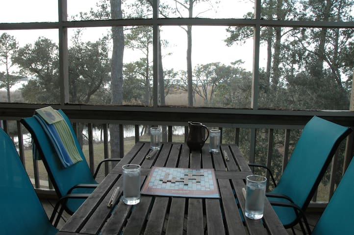 Dine outside any season on the screened deck
