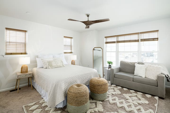 Plush queen mattress, twin pullout sofa, ample closet space, and private bathroom complete this gorgeous primary bedroom