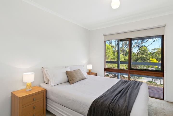The home comprises 2 lovely north-facing bedrooms with portable fans, heaters and built-in robes, roller blinds and block out drapes. The master has a lovely Queen bed, with outlook across the gum trees.