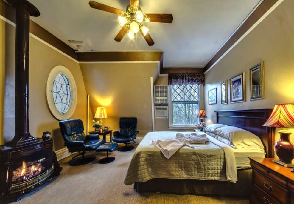 Queen Sleep Number bed and fireplace and whirlpool bath.