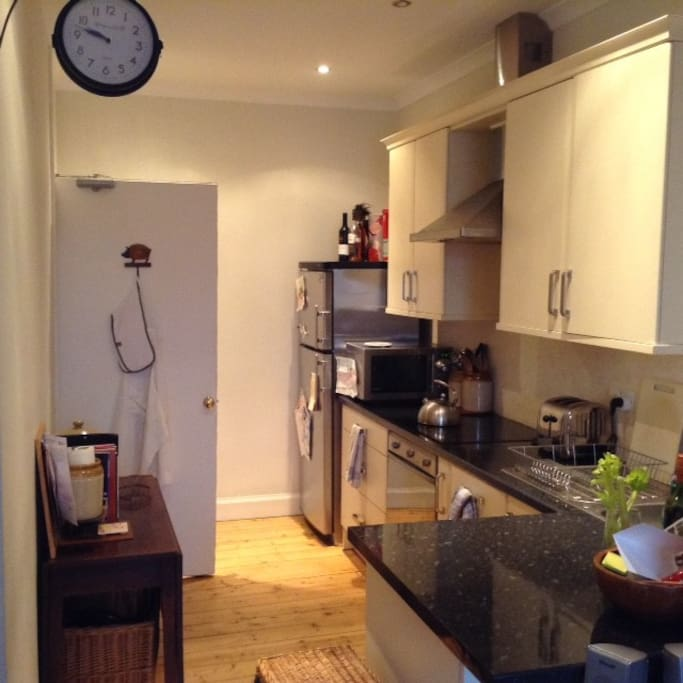 Fully fitted, accessorised kitchen with novel dual access to hallway and sitting room.