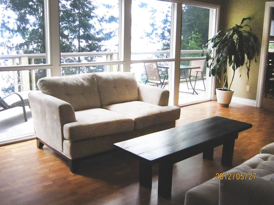 The two comfy sofas in the living room are great for relaxing and enjoying the view.