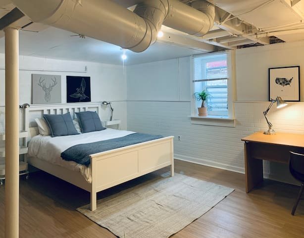 Basement bedroom with egress window and plenty of light.