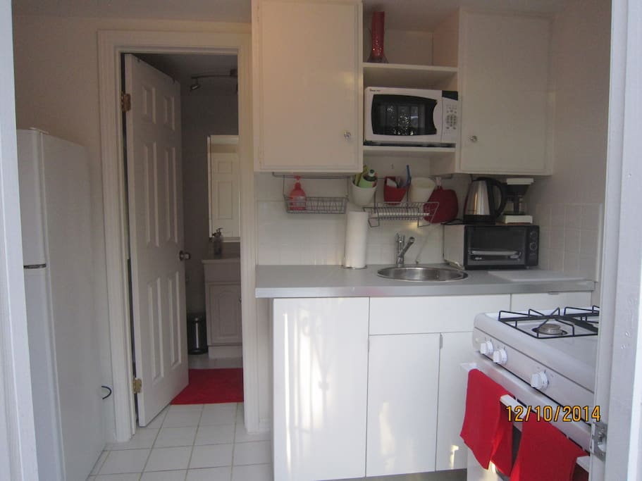 Full kitchen with microwave, coffee  maker, electric Kettle and more