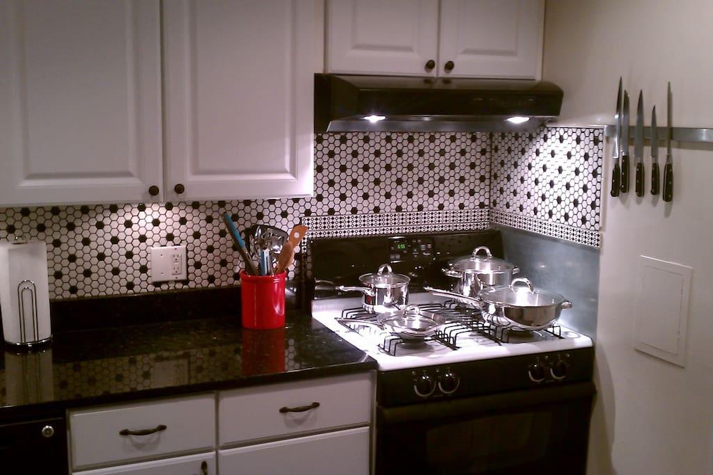 Full setup of pots, pans utensils etc.