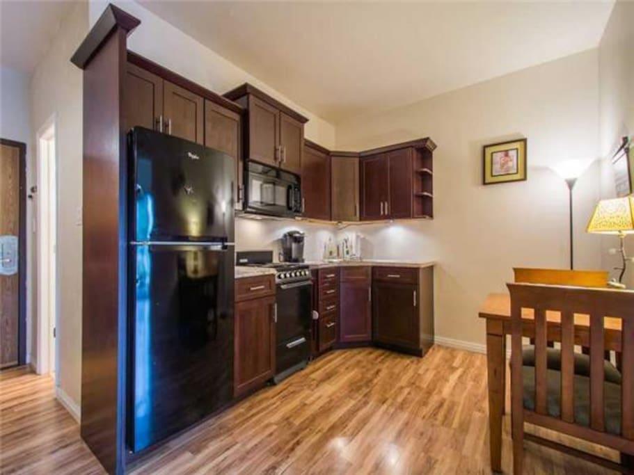 Kitchen- Fridge, oven, microwave, pots/pans, dishware etc coffee maker, espresso maker, toaster