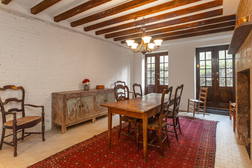 Dining room off kitchen on garden floor level opening to terraced gardens and patio
