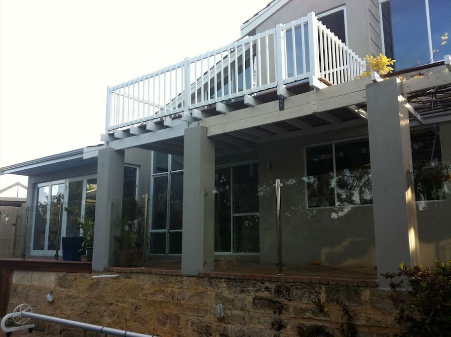 Back of the house overlooking the pool and entertainment area