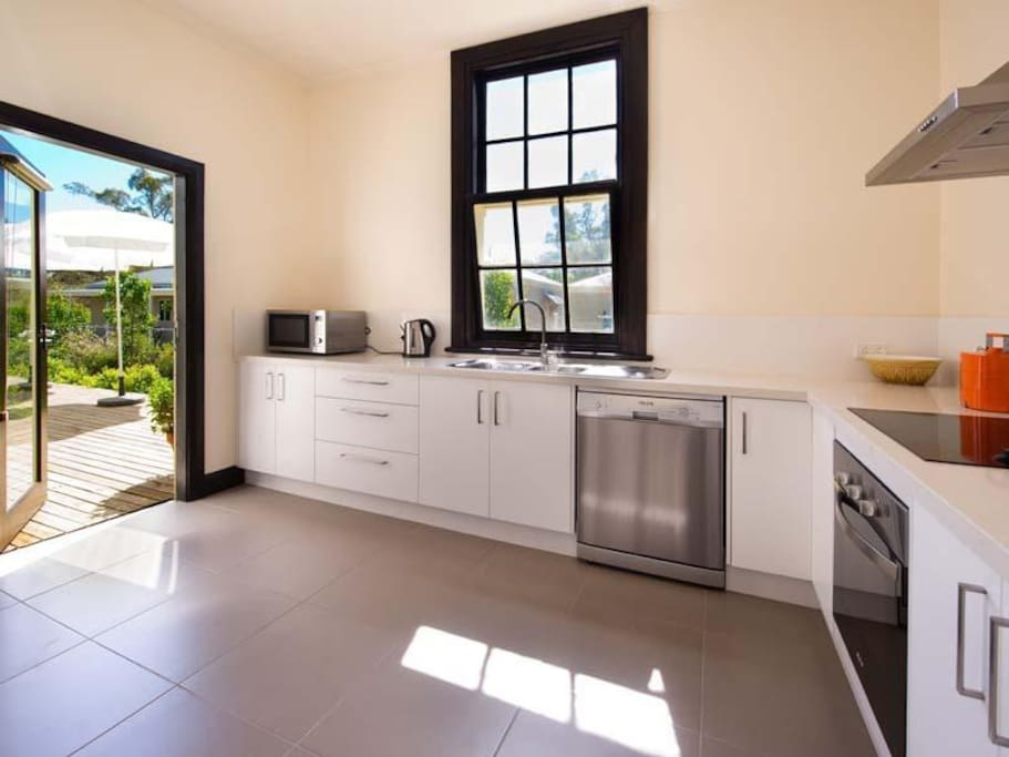 Generous breakfast supplies are provided in a modern kitchen with new appliances.