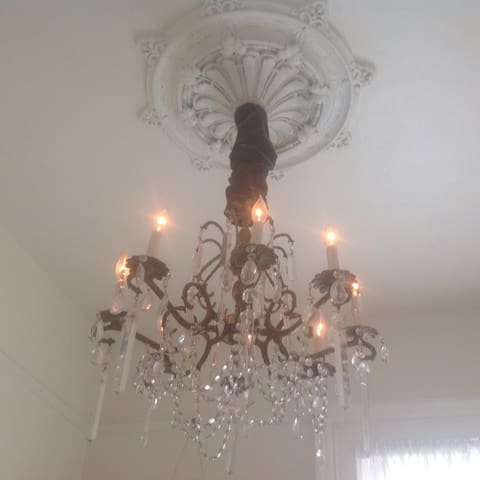 The chandelier in the white room.