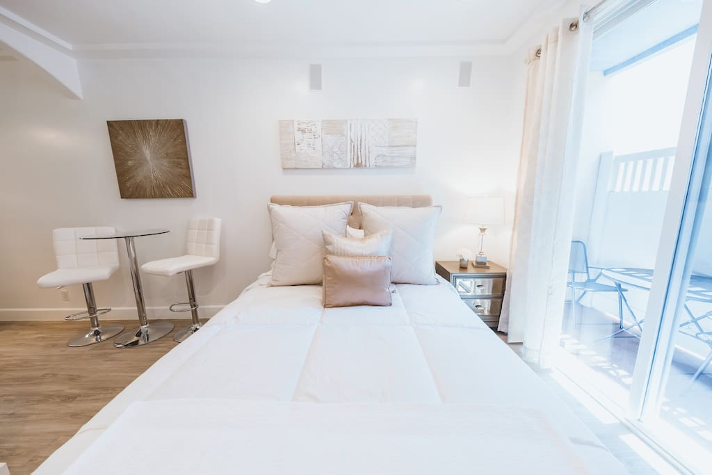 Queen size bed with down bedding and extra pillows