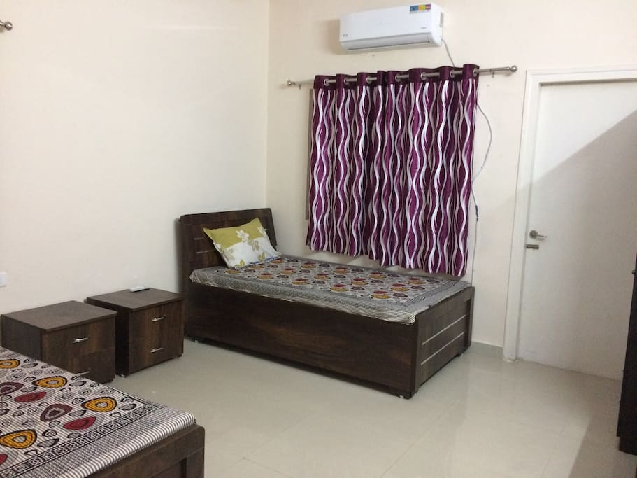 Room with two beds and AC