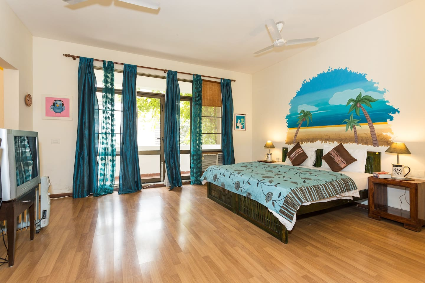 Large room with ensuite bath and small balcony