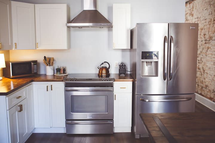 Electric range and Frigidaire appliances for your use in the kitchen.