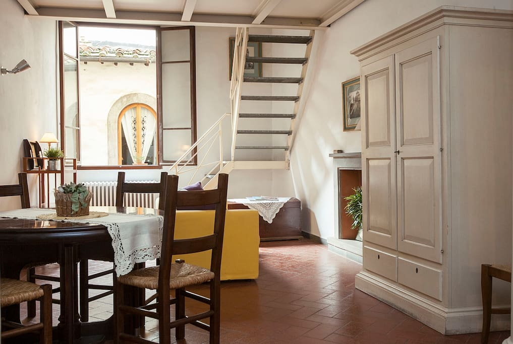 The main living area is very bright and spacious with original, Tuscan terracotta floors.