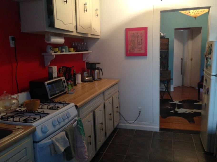 Large eat-in kitchen with full dining table and appliances