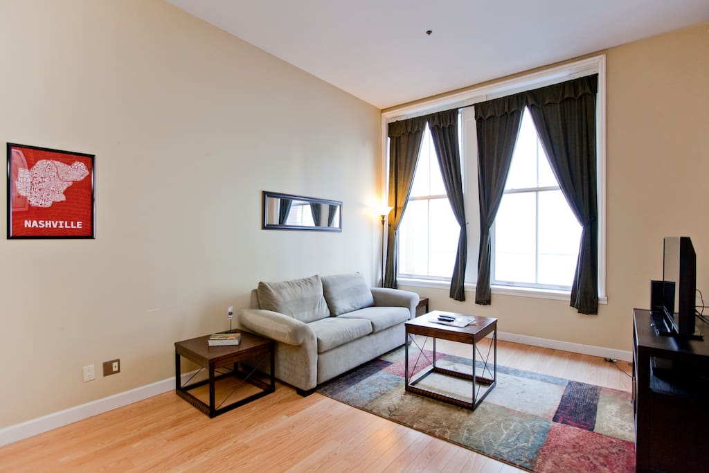 Spacious Living room looking onto 2nd Avenue.  Free Netflix!