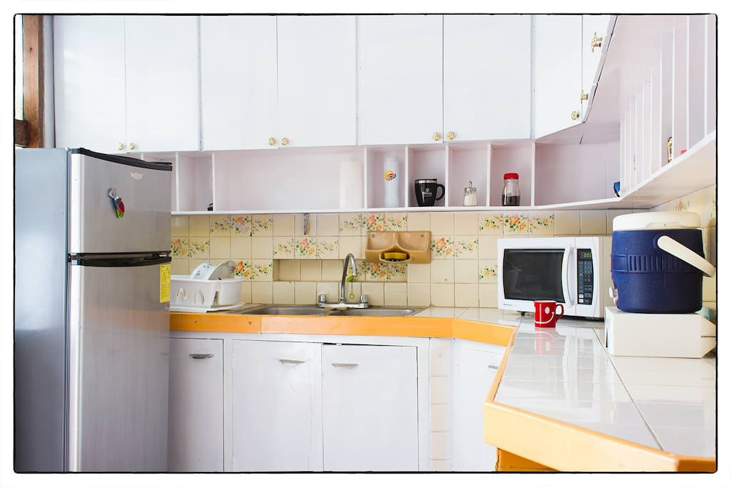 Shared kitchen with microwave , refrigerator , electric  stove, cutlery and crockery