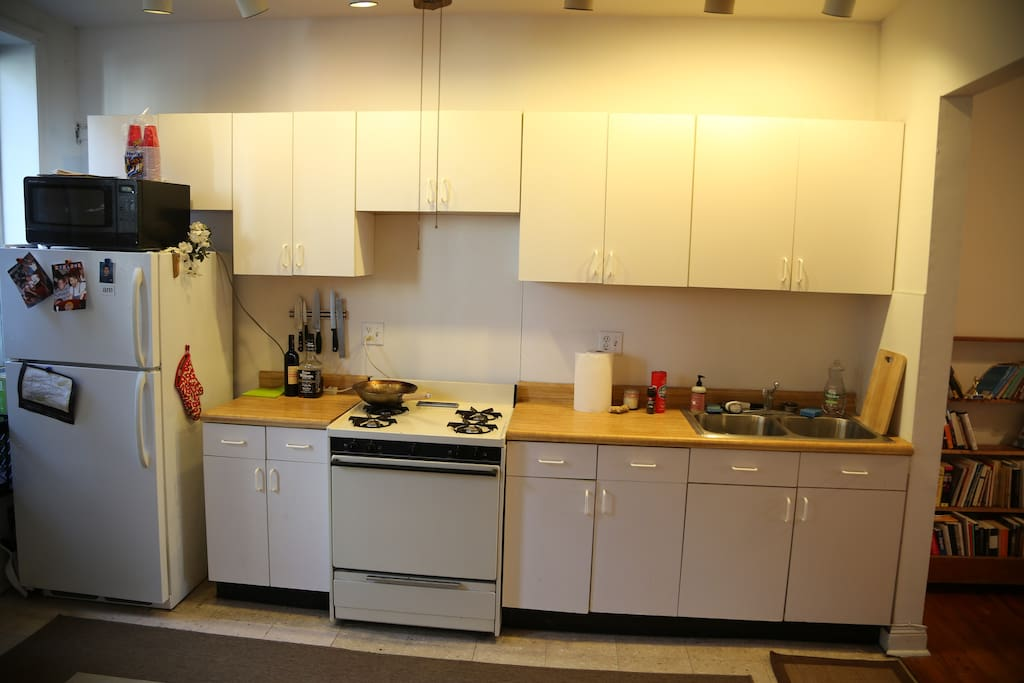 My wonderful kitchen, well-stocked with pots, pans, and dishes (I used to be a chef, so I take this seriously).