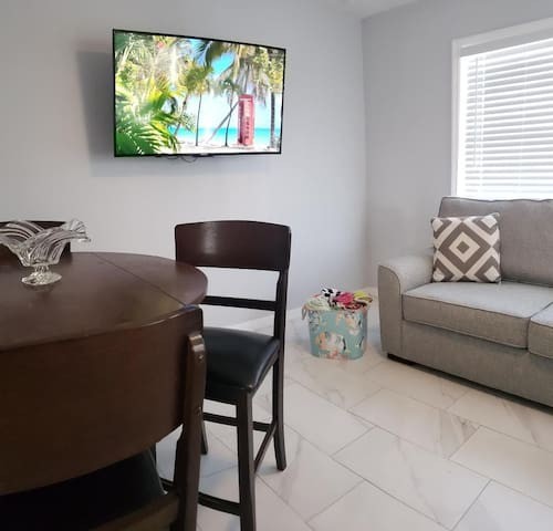 Small sunshine filled living room with sofa bed,  Large beach towels are available As well as Smart TV