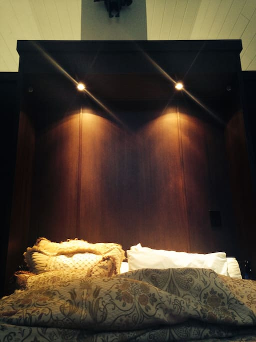 Custom built Murphy bed with built in overhead lighting