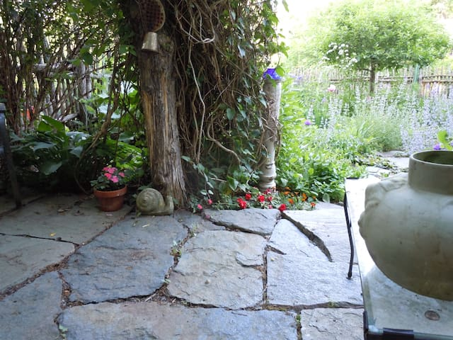 "this is a secluded patio in the ""big garden"" All of my gardens are open to our guests!"
