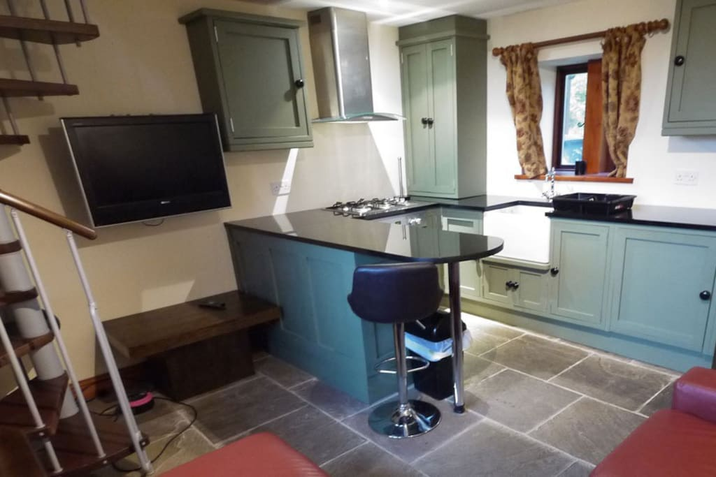 Kitchen, dining and living area. TV, DVD, fridge, cooker