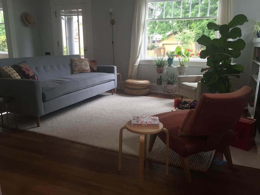 Large, comfortable sofa and rug in main floor living room.