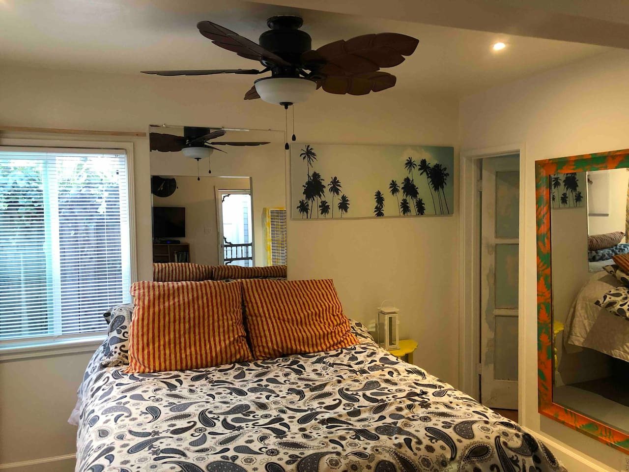 This is another wonderful picture of your cozy bed looking in from the living room of the kitchen to the right is the bathroom the bed has comfort pads completely Cozy with windows view of the court yard out side