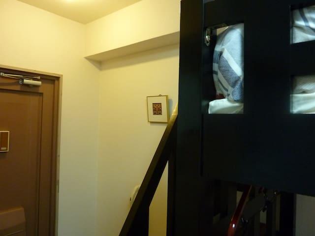 At the door.
