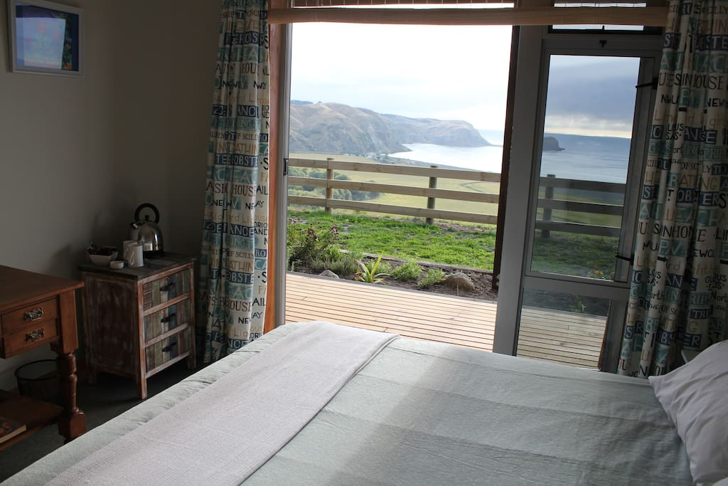 One of the guest rooms  looking out to Whakaari  headland.