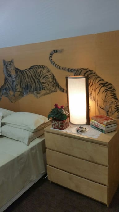 Hand painted silk Tiger panels bed head.