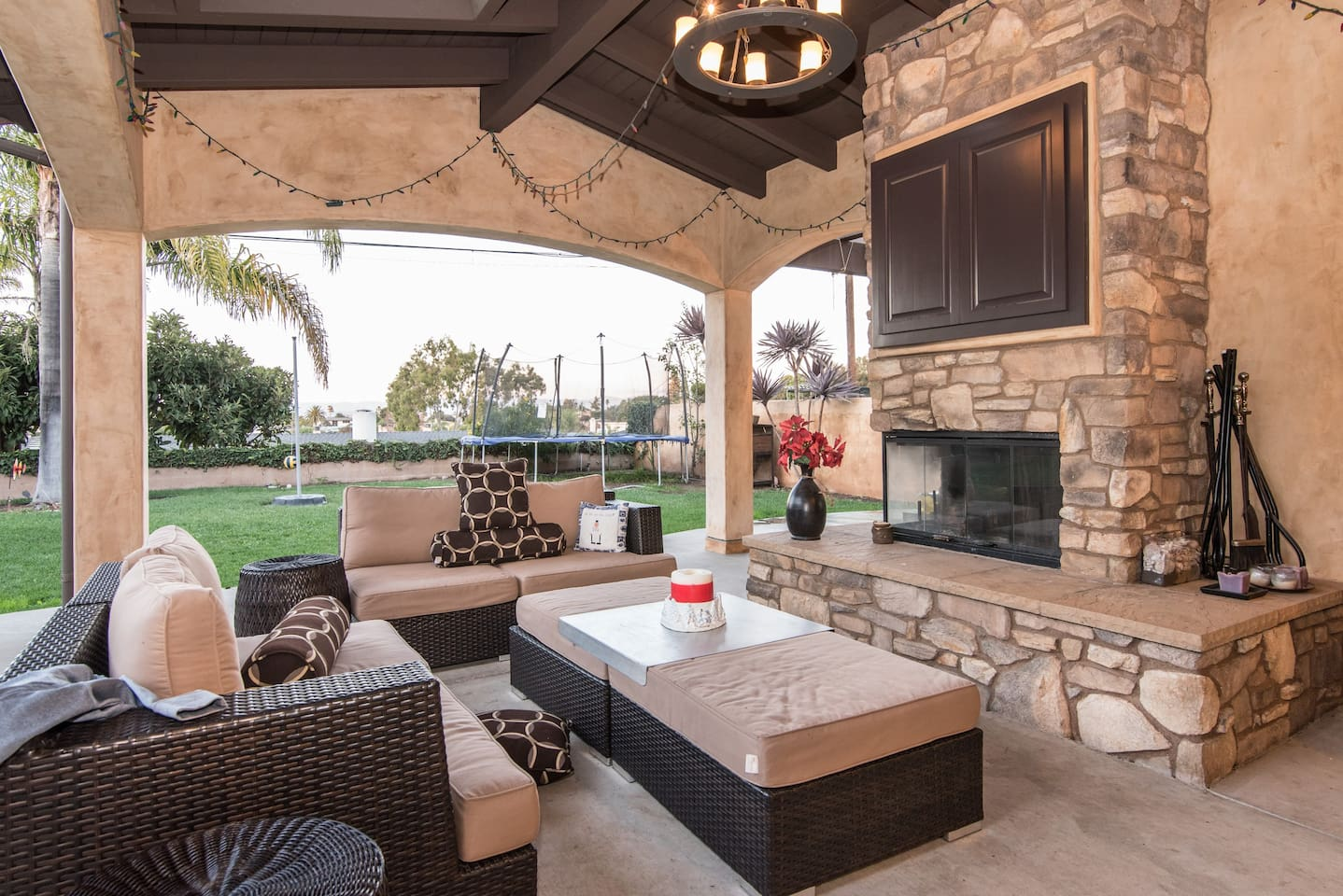 California means 'outside living'.  New home has a Loggia, complete with two double twin seated Sunbeam sofas, coffee table and Lennox all natural wood Fireplace.  We also have a Samsung flat screen hidden behind two Cabinets that swing open!