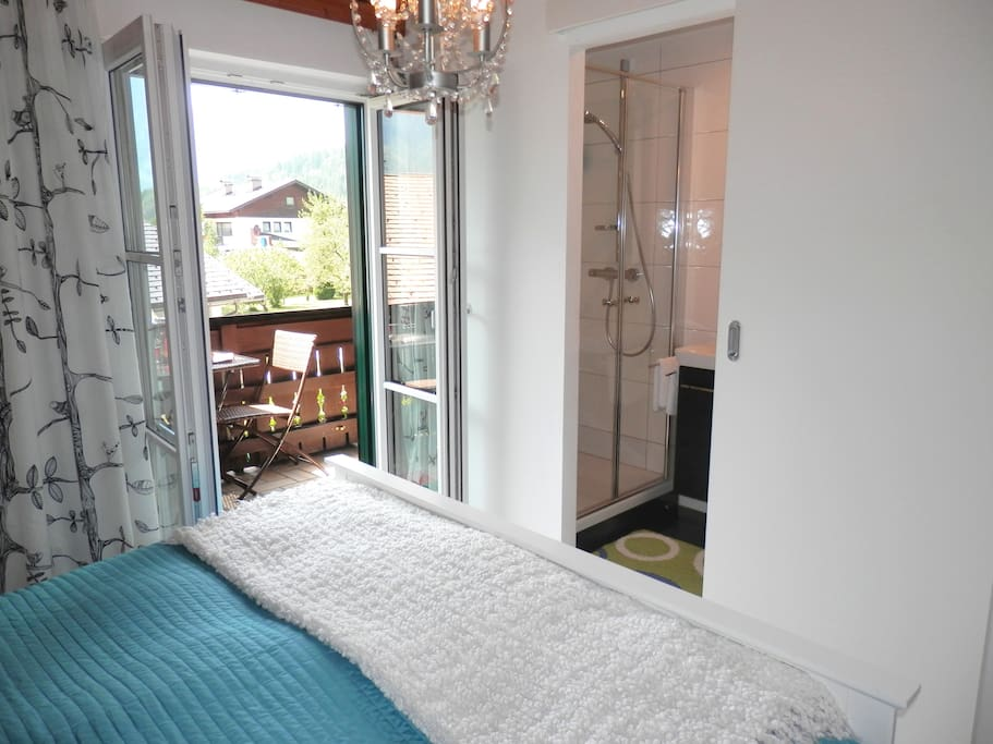 Large double bed with ensuite bathroom and direct access to the south facing balcony with breathtaking mountain views.