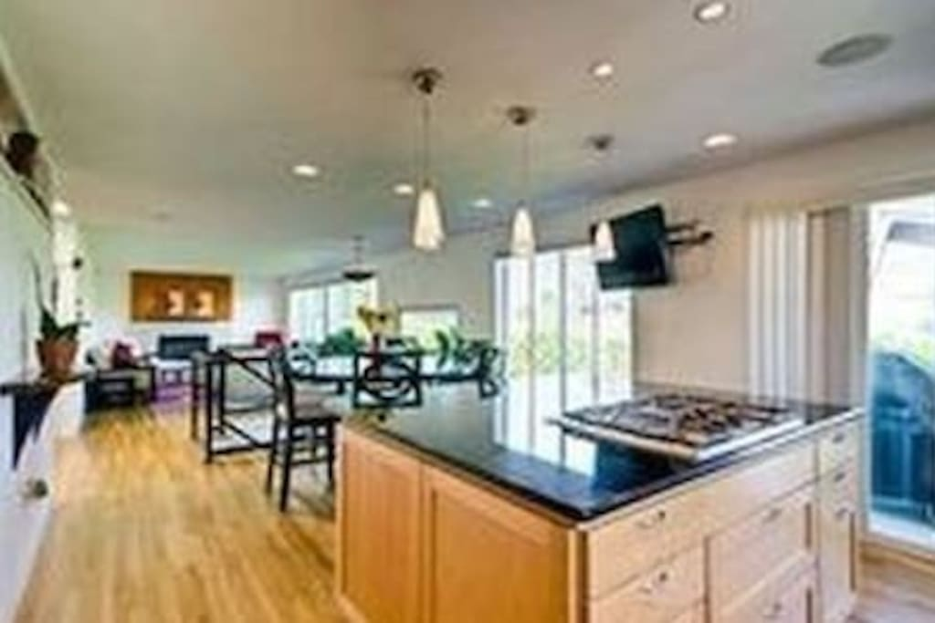 Open Kitchen for Family amd Friends sliding glass door leads to outdoor living decks.